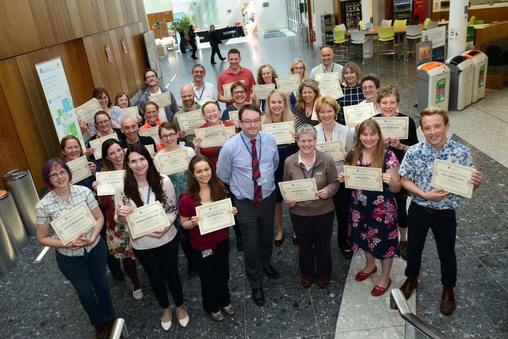 Staff and students with certificates at the RDSVS